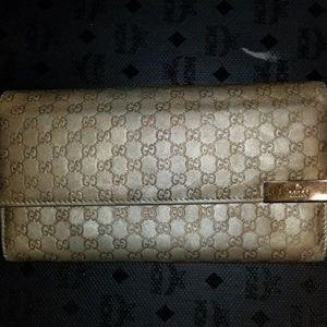 Gucci Guccissma long gold wallet. Authentic